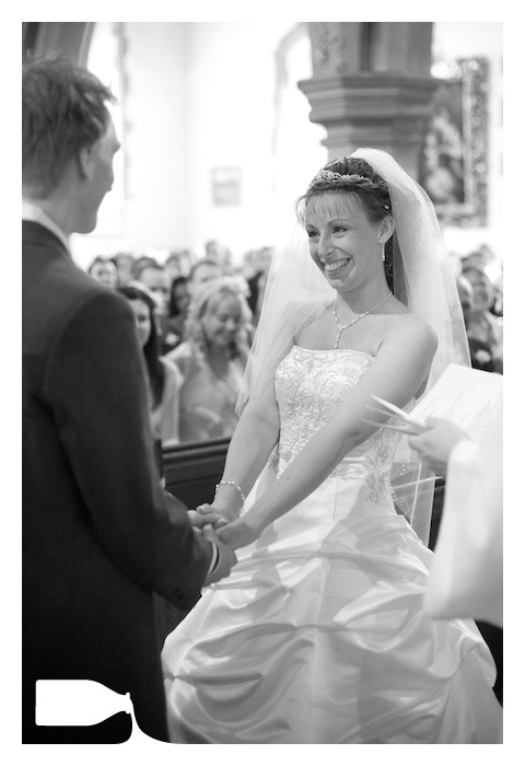 blushing bride on wedding day in church