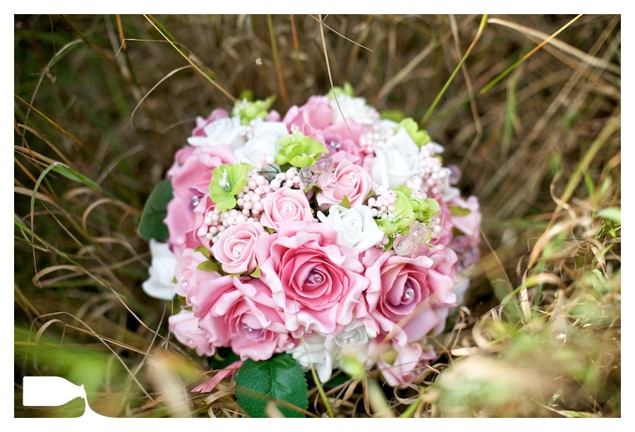 bride flowers on wedding day in long grass